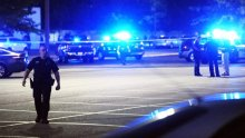 Advocate staff photo by LESLIE WESTBROOK -- Law enforcement and other emergency personnel respond to the scene of a shooting at the Grand 16 movie theater Thursday, July 23, 2015, in Lafayette, La. Multiple injuries are reported and the shooter is presumed dead.